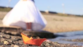 Paper Boat. Origami paper boat and a bride. Close-up stock footage