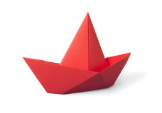 Paper boat. Origami red paper boat isolated on white background stock photos