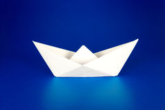 Paper boat. Over blue background Royalty Free Stock Photo
