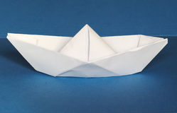 Paper boat over blue Royalty Free Stock Image
