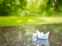Paper boat. Floating in a puddle Stock Photos