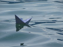 Paper boat. In the photo is paper boat on the lake Walchen Bavaria, Germany.n Stock Photography