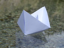 Paper boat. In the photo is paper boat on the river Isar near Vorderriß Bavaria, Germany Royalty Free Stock Images