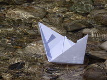Paper boat. In the photo is paper boat on the river Isar near Vorderriß Bavaria, Germany Royalty Free Stock Image