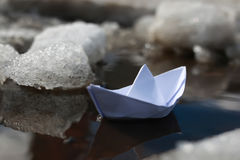 Paper boat in a pool Royalty Free Stock Images