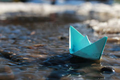 Paper boat in a pool Stock Image