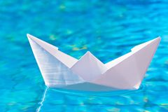Paper boat in the pool Stock Images