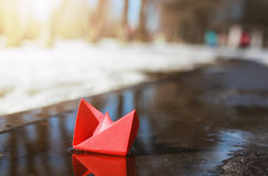 Paper boat in a pool winter Royalty Free Stock Photos