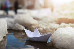Paper boat in a pool winter Royalty Free Stock Images