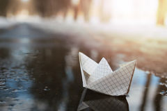 Paper boat in a pool winter Stock Photo
