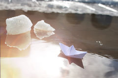 Paper boat in a pool winter Royalty Free Stock Photo