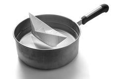 Paper boat sailing in a saucepan Stock Photography