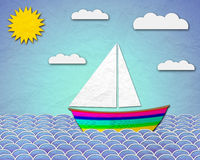Paper boat sailing at sea Stock Images