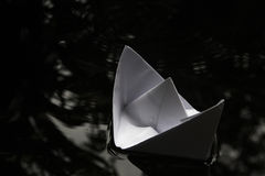 Paper boat sailing on water surface Royalty Free Stock Photo