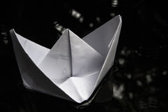 Paper boat sailing on water surface Royalty Free Stock Photography