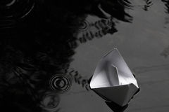 Paper boat sailing on water surface Royalty Free Stock Images