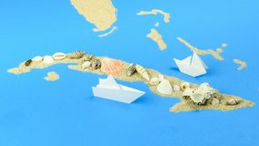 The paper boat floats off the coast of Cuba. A paper boat sails off the coast of Cuba. The contours of Cuba are lined with sand, on top - shells stock footage