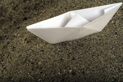 Paper Boat on sand Royalty Free Stock Images