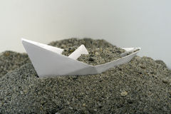 Paper Boat with sand Royalty Free Stock Images