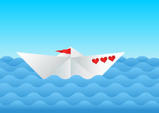Paper boat on the sea. White paper boat with three red hearts on the blue sea Royalty Free Stock Photography