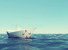 Paper boat in sea Royalty Free Stock Photography