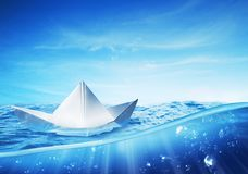 Paper boat at sea on a shiny day Stock Photo