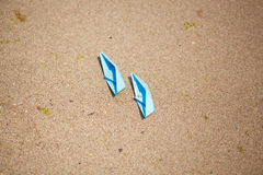 Paper Boat with shells and sand. Vocation and travel background Stock Images