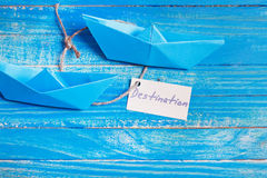 Paper Boat with a sign Destination - travel concept Royalty Free Stock Photo