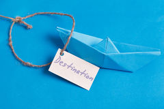 Paper Boat with a sign Destination - travel concept Stock Photography
