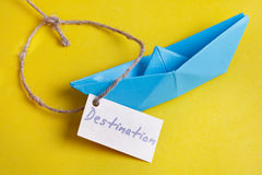 Paper Boat with a sign Destination - travel concept Royalty Free Stock Image