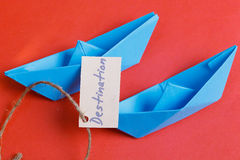 Paper Boat with a sign Destination - travel concept Stock Photos