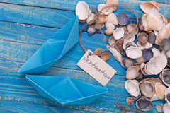 Paper Boat with a sign Destination - travel concept Royalty Free Stock Photos