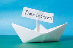 Paper Boat with a sign Time to travel Stock Images