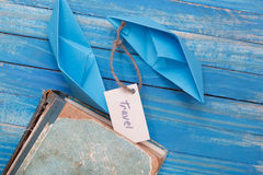 Paper Boat with a sign Travel with vintage book - travel concept Royalty Free Stock Photo