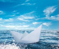 Paper boat in stormy sea Stock Photo
