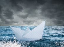 Paper boat in stormy sea Stock Photography