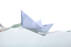 A paper boat in transparent water Royalty Free Stock Image