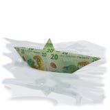 Paper boat with twenty new zealand dollar bills Royalty Free Stock Photos
