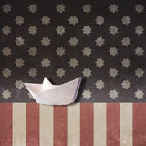 Paper Boat on Usa Flag Royalty Free Stock Photo