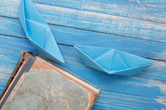 Paper Boat with vintage book Stock Image