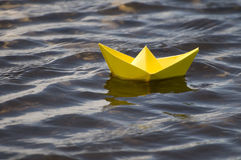 Paper boat in water Royalty Free Stock Photo