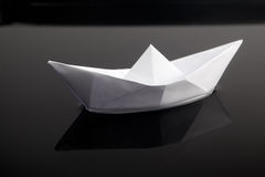 Paper boat in water Stock Image