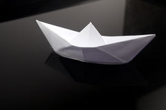 Paper boat in water Stock Images