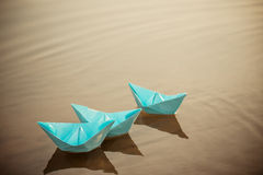 Paper boat on the water. Blue paper boat on the water Stock Photo