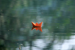 Paper boat on water Royalty Free Stock Photos