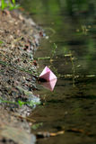 Paper boat on water Stock Photo