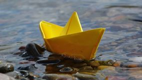 Paper boat on the water royalty free stock photo