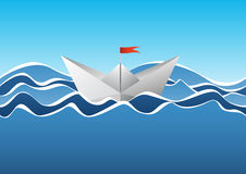 Paper boat on the waves Stock Image
