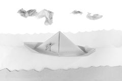 Paper boat in a white paper sea Stock Images