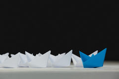 Paper boats arranged together Royalty Free Stock Photos